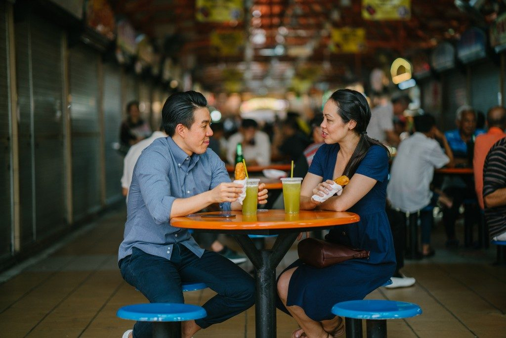 couple dining in hawker place in Singapore