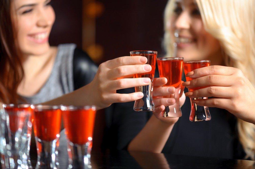 girls drinking shots