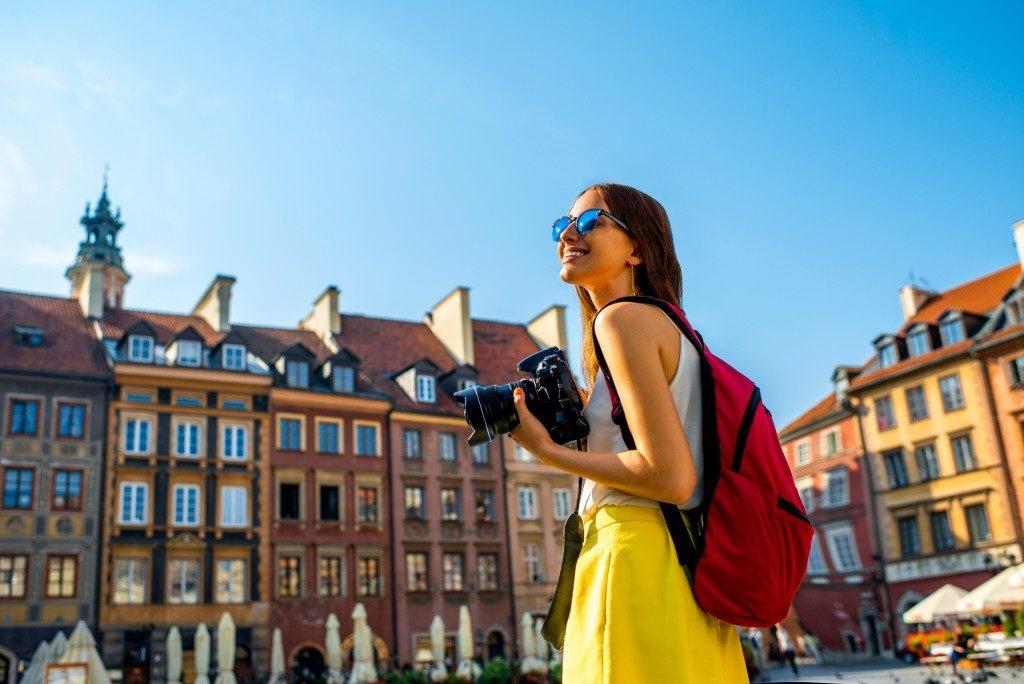 tourist woman roaming around city